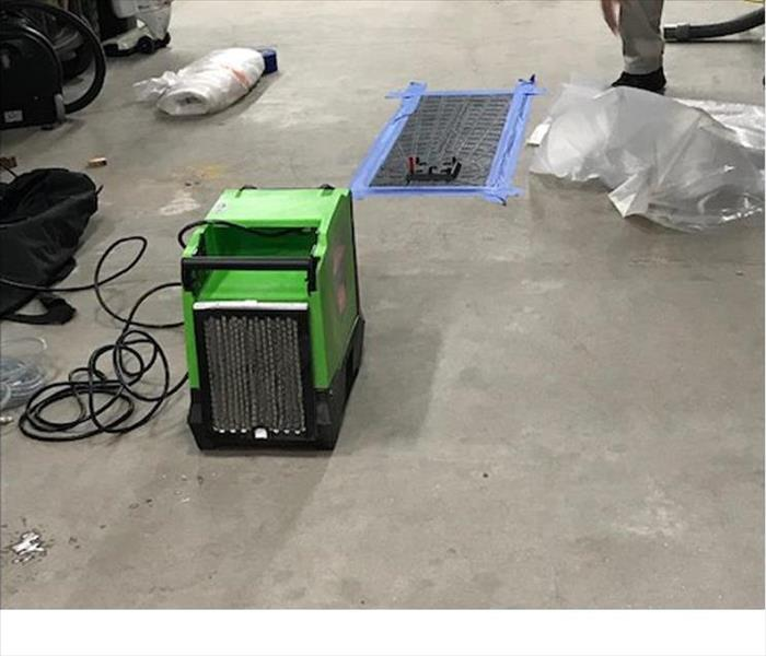 air scrubber on concrete pad