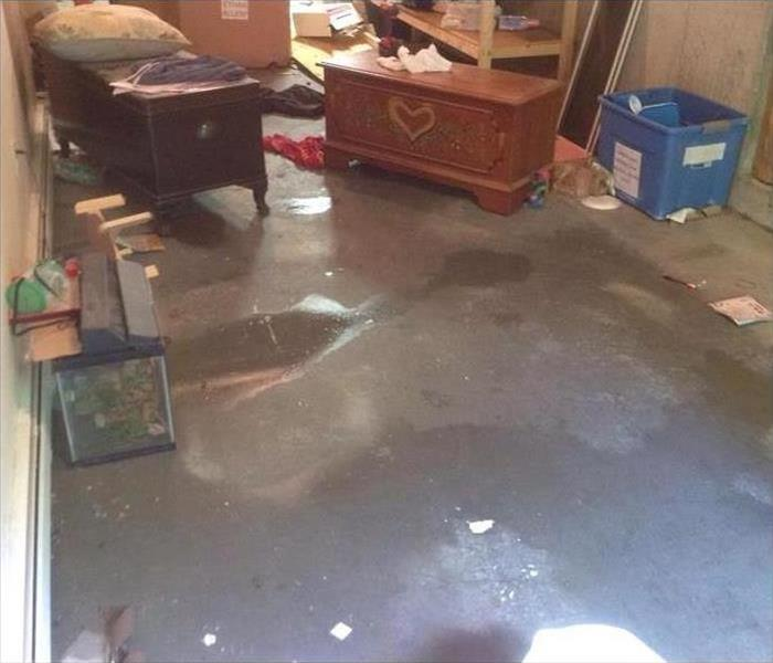 water on concrete floor, scattered contents