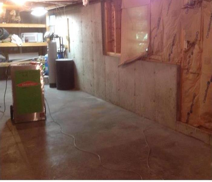 dry floor pad, insulation showing from removed wall panels with window
