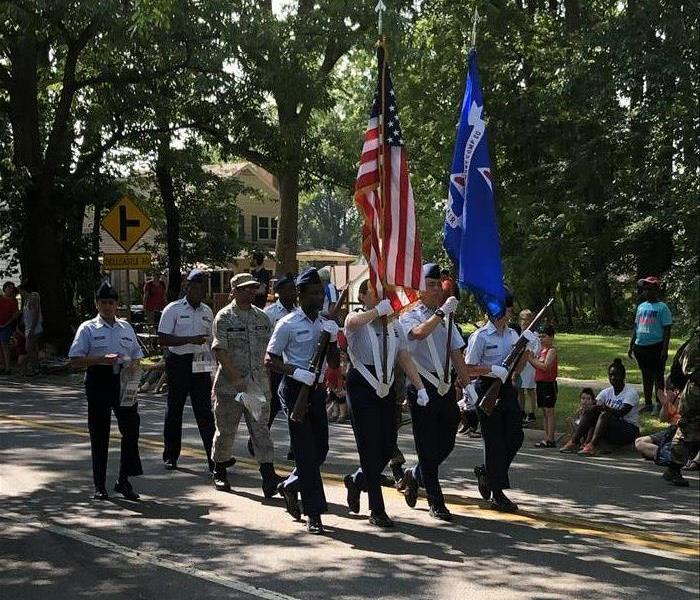 Soldiers carrying American Flags