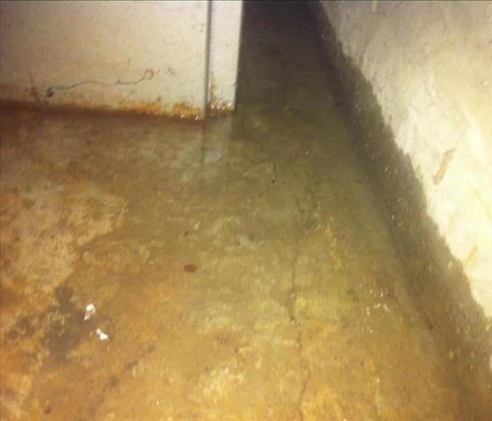 concrete pad and walls flooded in a basement