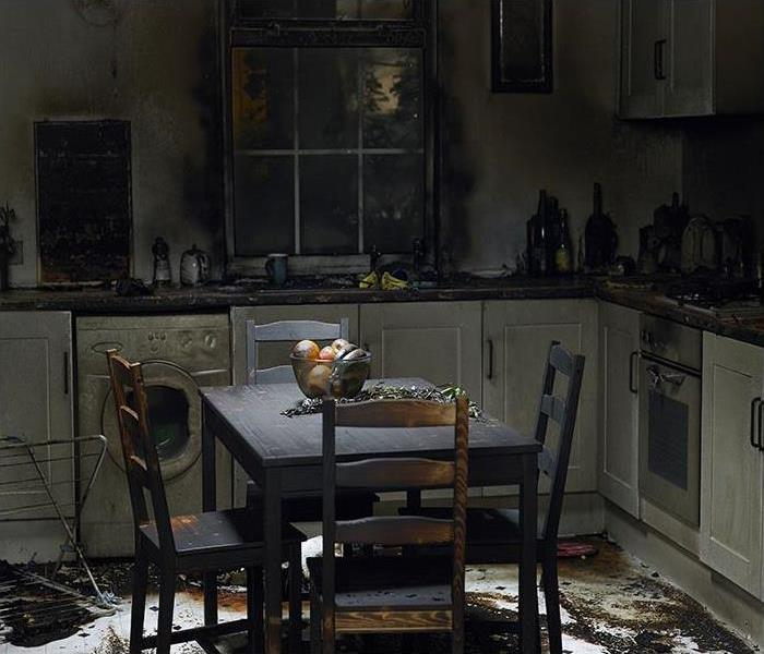 kitchen burnt in fire and covered in soot
